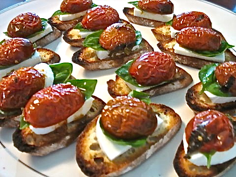 Roasted tomato, fresh mozzarella, basil on crostini